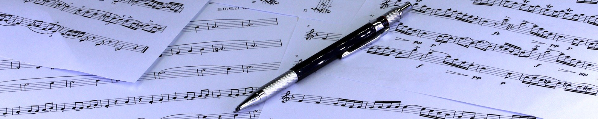 sheets of music and pen